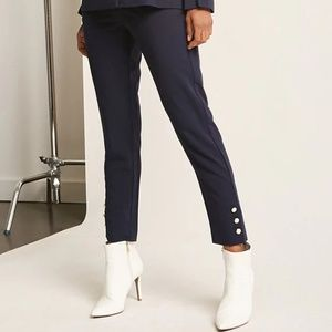 Dark blue pants with pearl detail along the leg